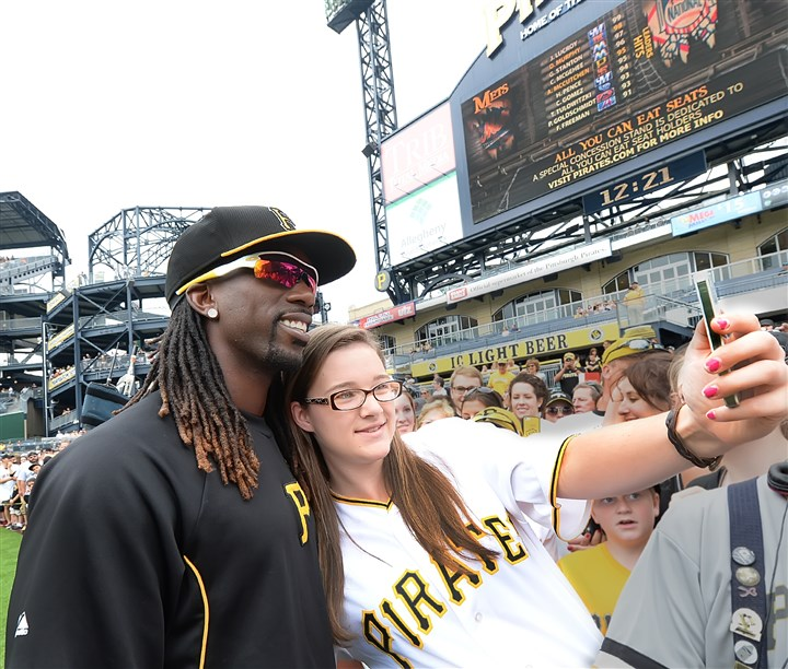 Andrew McCutchen The Pirates' Andrew McCutchen takes a selfie with Grace McBride during the Pirates Photo Fest at PNC Park.