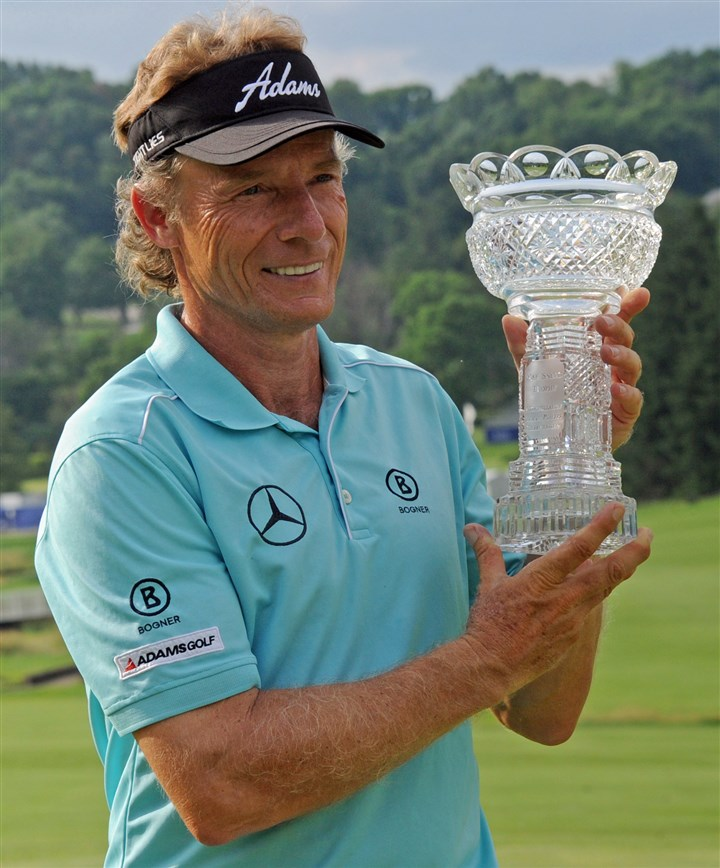 20140629mfgolfsports05-4 Bernhard Langer holds the trophy after winning the Constellation Senior Players Championship Sunday at Fox Chapel Golf Club.