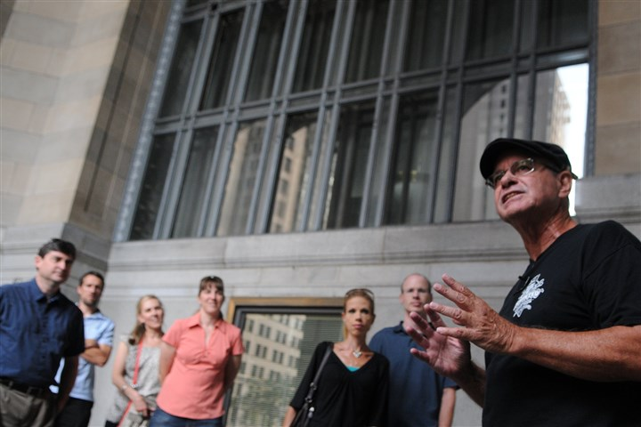 20140627DARtourLocal07-6 Local guide Haydn Thomas, of Pittsburgh Haunted Tours, shares a ghost story with guests on a recent tour. Here, he tells them about the history of the City-County Building as the tour begins.