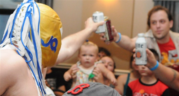 """Joey Quervo 'The Drunken Luchadore'"" toasts fan ""Joey Quervo 'The Drunken Luchadore'"" toasts fans in his usual way, raising a beer can. He is one of the many personalities of Pittsburgh's Keystone State Wrestling Alliance. The KSWA declined to reveal the name of the man behind the mask."