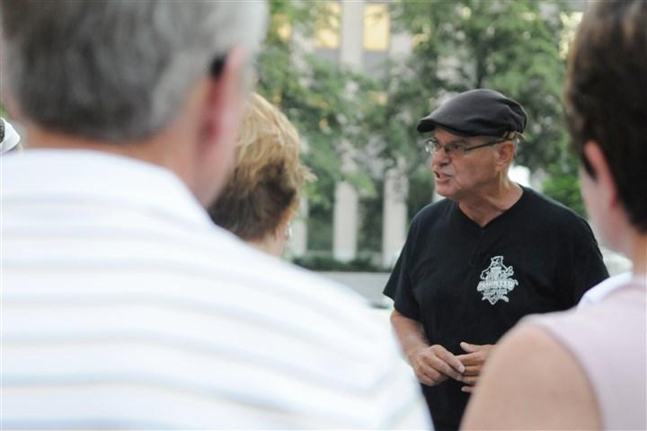 20140627DARtourLocal08-7 Local guide Haydn Thomas, of Pittsburgh Haunted Tours, shares a ghost story with guests on a recent tour. Here, he stands in Mellon Square Park and tells them about the history of the Penn Hotel.