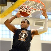 Pitt's Sheldon Jeter dunks in the 2014 Pittsburgh Basketball Club Pro-Am League.