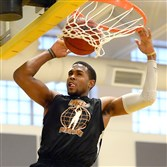 Pitt's Sheldon Jeter dunks at a PBC Summer Pro-Am League game in 2014. The league is being revived this year.