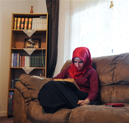 Zaynep Koc, 16, of Greenfield Zaynep Koc, 16, of Greenfield, reads a book in her family's home. The Koc family has lived in Pittsburgh after leaving Turkey about 10 years ago. Zaynep, the Kocs' oldest child, worries that the high tuition fees facing most undocumented college students will prevent her from continuing her education in America.