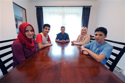 The Koc family  From left, Zeynep, 16, Muhammed, 15, Bunyamin, Asuman, and Yunus Koc, 13, sit at the dining room table in their Greenfield home. The Koc family has lived happily in Pittsburgh after leaving Turkey almost 10 years ago.