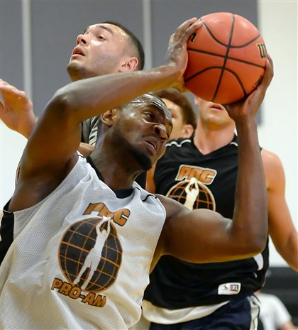 20140630mfbballsports02-1 Pitt's Joseph Uchebo competes in the Pittsburgh Basketball Club Summer Pro/Am League June 30.