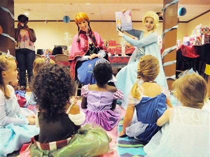 Courtney Czarniak of Bridgeville with Katie Oxman of Oakland Courtney Czarniak of Bridgeville (left), along with Katie Oxman of Oakland (right) in costume as the Ice Princess and Ice Queen, read a story to children at a princess-themed birthday party in Belle Vernon.