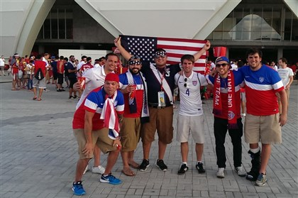 localCup Jim Taylor, 39, of Robinson, far left, with other U.S. fans before United States faced Portugal in World Cup group play.