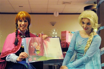Courtney Czarniak of Bridgeville along with Katie Oxman of Oakland Courtney Czarniak of Bridgeville (left), along with Katie Oxman of Oakland (right) in costume as the Ice Princess and Ice Queen, read a story to children at a princess-themed birthday party in Belle Vernon.