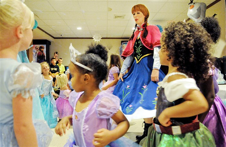 Courtney Czarniak of Bridgeville in costume as the Ice Princess Courtney Czarniak of Bridgeville, in costume as the Ice Princess, dances with children dressed as princesses at a birthday party in Belle Vernon.