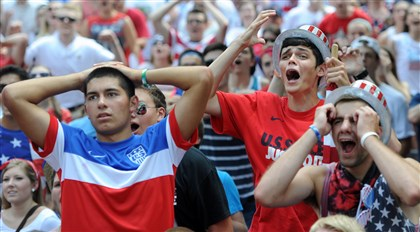 20140701mfsoccerlocal02-1 Fans react to an early scoring chance by USA against Belgium in regulation during a World Cup viewing party in Market Square Tuesday afternoon.