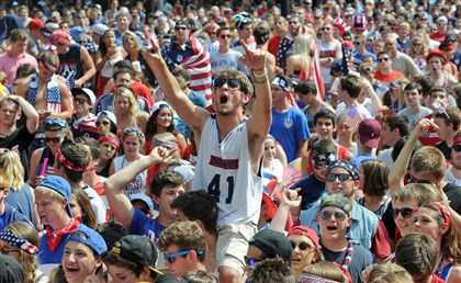20140701mfsoccerlocal05-4 Fans enjoy a World Cup viewing party in Market Square Tuesday afternoon as USA takes on Belgium.