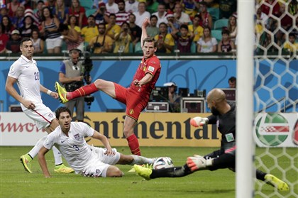 Howard makes a save United States' Omar Gonzalez and Geoff Cameron watch as goalkeeper Tim Howard makes a save on Belgium's Jan Vertonghen shot on goal during the World Cup round of 16 soccer match between Belgium and the USA at the Arena Fonte Nova in Salvador, Brazil, Tuesday, July 1, 2014.
