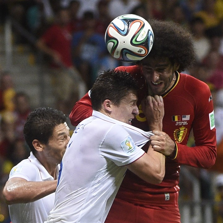 US defender Matt Beslervies  U.S. defender Matt Beslervies with Belgium's midfielder Marouane Fellaini during a Round of 16 football match between Belgium and USA at Fonte Nova Arena in Salvador during the 2014 FIFA World Cup on July 1, 2014.