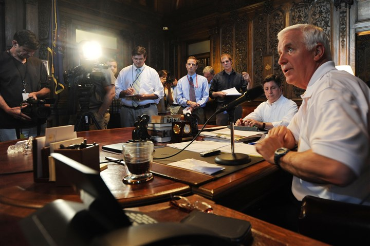 CorbettBudget Pennsylvania Gov. Tom Corbett, right, along with Lt. Gov. Jim Cawley, center, hold a news conference Sunday in Harrisburg.
