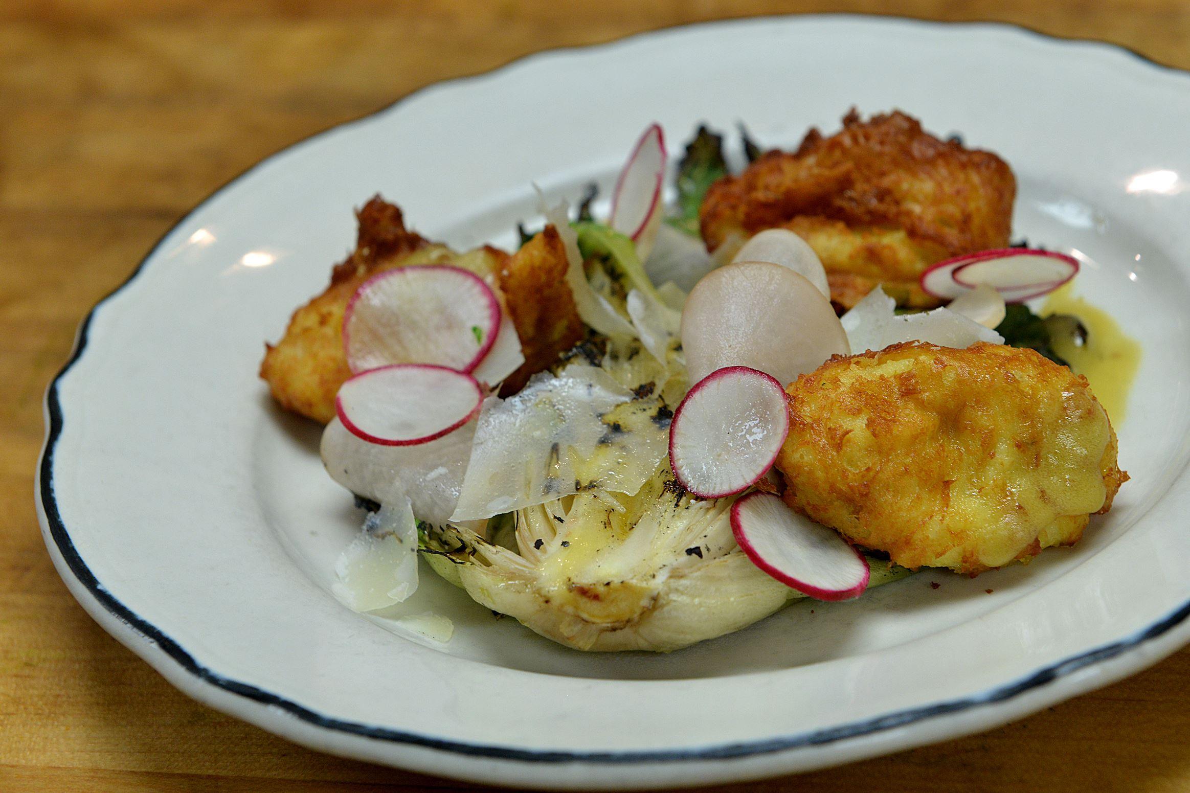 20140701lrlegumedine02-1 Legume in Oakland also serves up a dish of escarole with beignet salad.