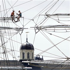 stormArthurW Crew members of the restored whaling ship Charles W. Morgan secure sails and lines Wednesday in New Bedford, Mass., in preparation for winds from Tropical Storm Arthur. The storm is expected to grow into a hurricane off the North Carolina coast and track northward offshore. At rear is the dome of the New Bedford Whaling Museum.