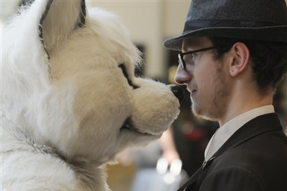 20140702DARanthroconLocal08-7 A furry, who identified himself only as Kellerman B., right, gets close to a costumer.
