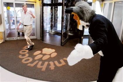 20140702CMFurriesLocal002-1 Pat Kane of Squirrel Hill waves to the furry greeter at the Westin Hotel downtown. The Westin will be home for the next three days to many attendees of Anthrocon 2014, the annual gathering of fans of personified animal characters.