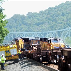 20140702rldTrainDerailment03 Workers inspect the scene of a train collision that happened Wednesday in Sewickley. Two people were injured when three locomotives and one car derailed.