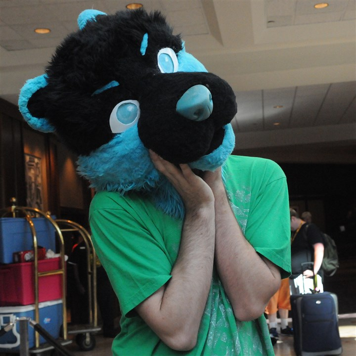 20140702CMFurriesLocal005-4 Josh Cheesborough of Smyrna, Tenn., poses in part of a furry costume at the Westin Hotel downtown.