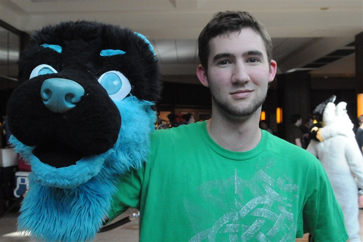 20140702CMFurriesLocal004-3 Josh Cheesborough poses with part of a furry costume.