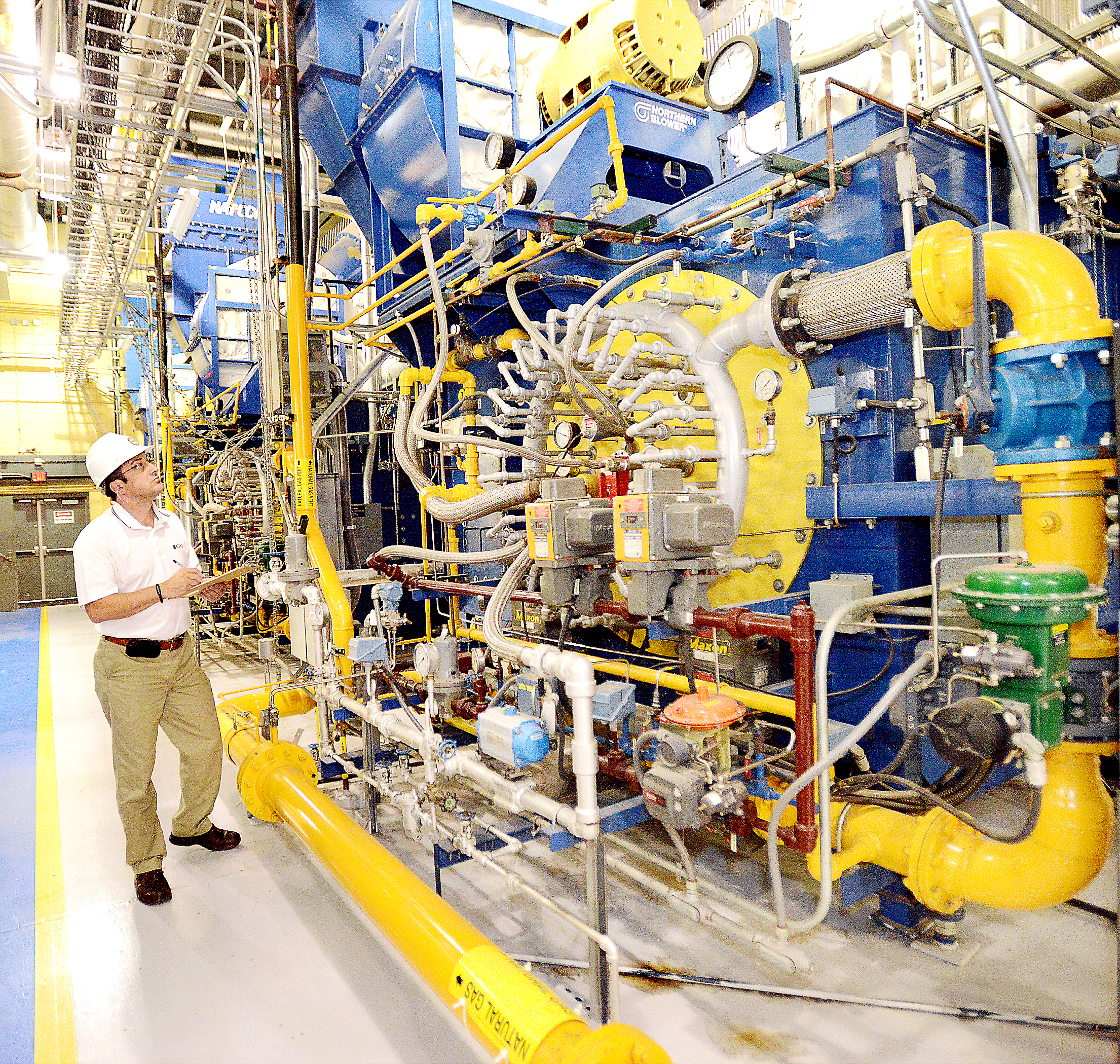 20140702radPittSteamBiz01 Marian Gagu, Plant Manager at Pitt's Carrillo St. Steam Plant where six gas-fired boilers have helped significantly reduce emissions. Multiple nozzles feed gas into each boiler in a circular pattern which is accelerated by blown air to achieve a more efficient burn.