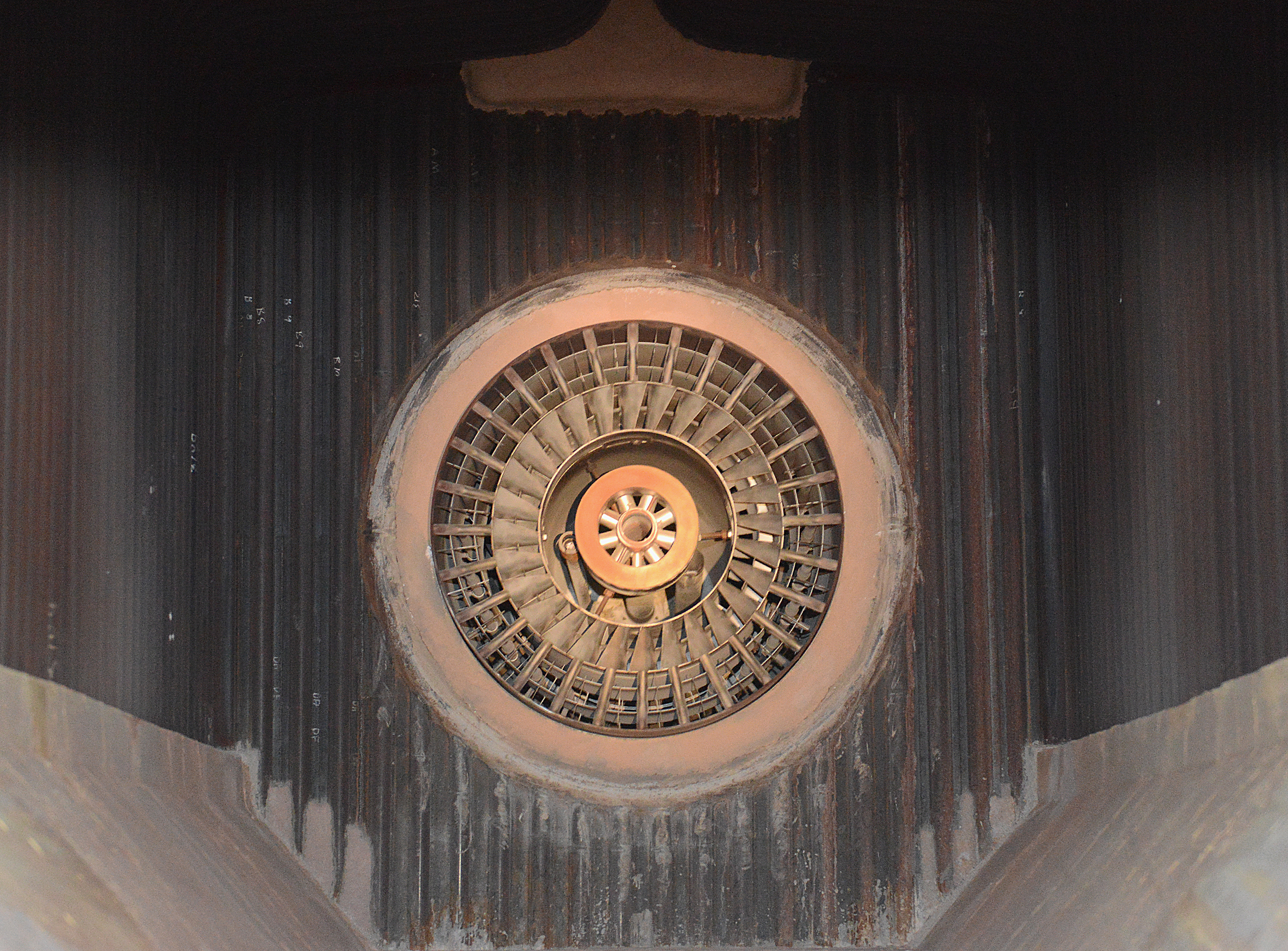 20140702radPittSteamBiz03-2 Inside a boiler open for inspection, the turbo fan that mixes air with gas ignited from multiple nozzles in a circular pattern can been seen. The plant's six gas-fired boilers have helped significantly reduce emissions.
