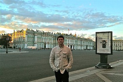 Istomin in St. Petersburg Mikhail Istomin in St. Petersburg, Russia, with the Winter Palace on the background.