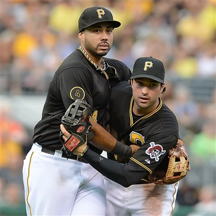 20140703pdPiratesSports03-1 edro Alvarez and Neil Walker come together for fly out against the Diamondbacks.