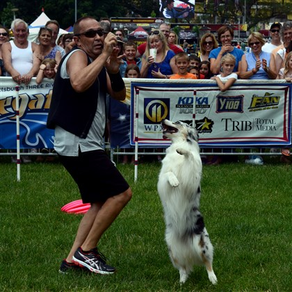 20140703lfRegattaLocal02-1 Elektra, a 7-years-old Australian Shepherd, dances with her owner Tony Hoard during the K9 Crew Trick Dog Thrill Show.