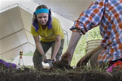 20140702ssdig-loc4 Senior Breanna Bieganski, left, removes the flow zone of soil from a unit Wednesday with help from senior Sarah Newhard. To excavate a unit, students took off individual layers and then sifted the dirt.
