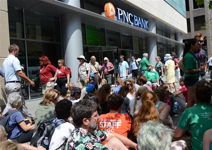 20140703ppQuakerProtest3LOCAL Members of the Earth Quaker Action Team Action Thursday , protests PNC Banks continued financing of mountaintop removal coal mining under PNC Banks green wall at the corner of Fifth Avenue & Wood Street, Downtown Pittsburgh.