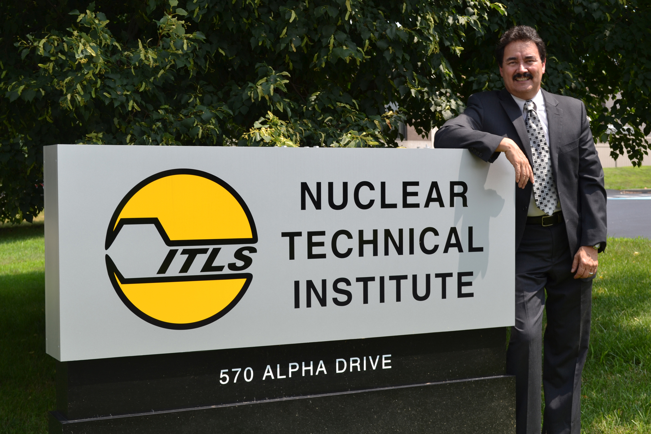 20140703hdWenzigBiz Industrial Technology Laboratory Services president A.M. (Marty) Wenzig stands in front of his company's Nuclear Technical Institute which certifies people in nuclear inspection.