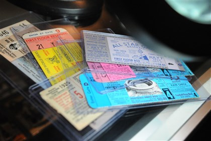 Several vintage ticket stubs Several vintage ticket stubs on display under the illuminated magnifying glass in Dean Means' store, Sports World Specialties.