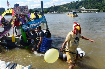 20140701MWHfloatsLocal11-10 Bruce Thompson, of the North Side, exits the Ohio River after competing in the Anything That Floats contest, Downtown.