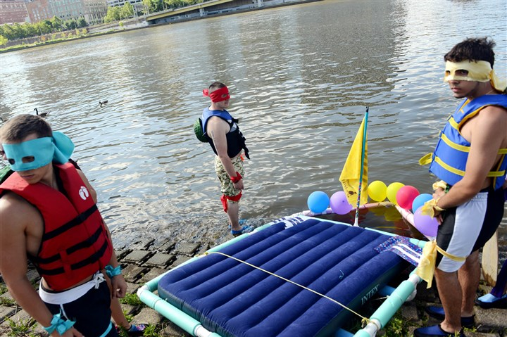 20140701MWHfloatsLocal06-5 Dressed as Teenage Mutant Ninja Turtles, from left, Elliot Connors and Dan Rutledge, of Rome, N.Y., and Trevor Duke, of Baldwin, prepare for the Anything That Floats race on the Allegheny River, Downtown.