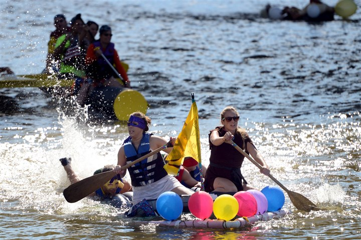 20140701MWHfloatsLocal09-8 Sisters Kara Kotary, left, and Taylor Kotary, of Rome, N.Y., paddle their entry Land Ho during the Anything That Floats race this morning on the Allegheny River as part of the Three Rivers Regatta, Downtown.