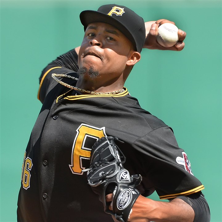 20140705pdPiratesSports02 Pittsburgh Pirates starter Edison Volquez delivers against the Phillies at PNC Park.