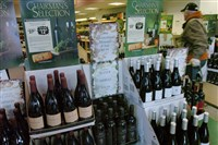 The liquor privatization plan would allow about 14,000 beer-sales license holders — retailers, restaurants, grocery stores and others — to pay a higher fee for permission to also sell wine, liquor or both.