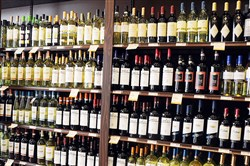 House Bill 466 gives beer distributors a full year to buy up licenses for 1,200 private liquor stores before other retailers would get a shot.