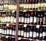 Opponents say a new plan approved by the state House could spell the end of state-owned liquor stores.