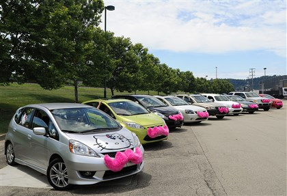 20140706CMLyftProtestLocal005-4 Lyft cars line up in a parking lot at the Waterfront in Homestead.