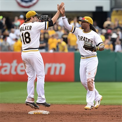 20140707pdPiratesSports08-8 Neil Walker and Andrew McCutchen celebrate the team's sweep of the Phillies at PNC Park.