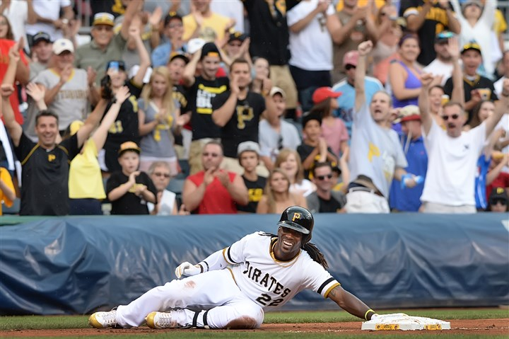 20140707pdPiratesSports06-6 Andrew McCutchen slides into third on a triple that was reviewed for fan interference.