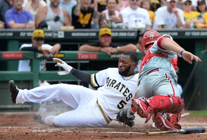 Josh Harrison vs. Phillies catcher Cameron Rupp The Pirates' Josh Harrison slides safely past the tag of Phillies catcher Cameron Rupp.