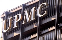 """UPMC "" atop of the U.S. Steel Tower in Downtown Pittsburgh. The company just opened offices in Columbia"