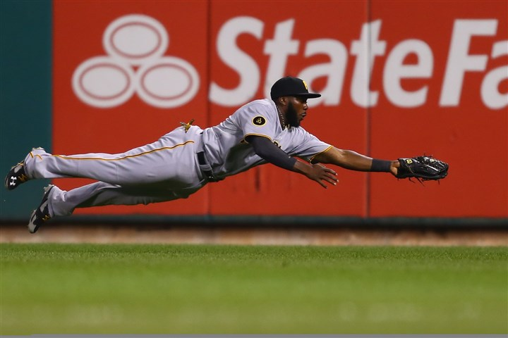 bucs0708c-2 Josh Harrison catches a fly ball in the second inning against the St. Louis Cardinals at Busch Stadium.