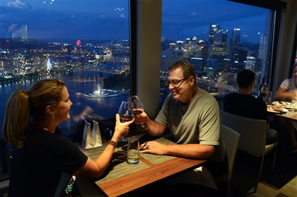 Helene and Regis McQuaide, Jr. of Mt. Lebanon Helene and Regis McQuaide, Jr. of Mt. Lebanon dine at Altius Restaurant on Mt. Washington, the night skyline of Downtown in the background.
