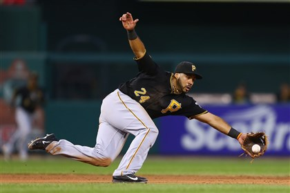 bucs0709e-1 Third baseman Pedro Alvarez fields a ground ball in the fourth inning Tuesday night in St. Louis.